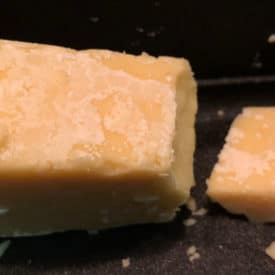 The white crust on this aged cheddar might appear to be mold at first glance, but it's actually calcium lactate crystals, which are safe to eat.