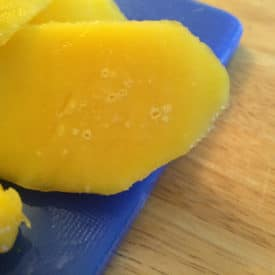 You can eat a mango with little white circles inside