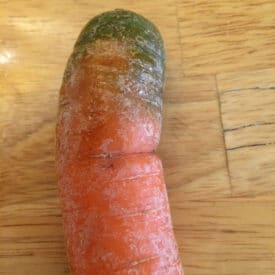Carrot with green top