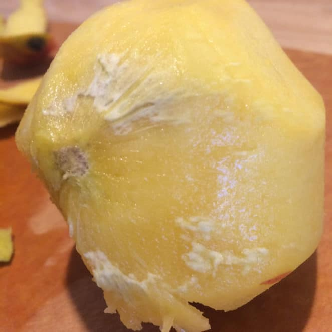 A mango with white stuff under the peel is still OK to eat, but may not taste as good.