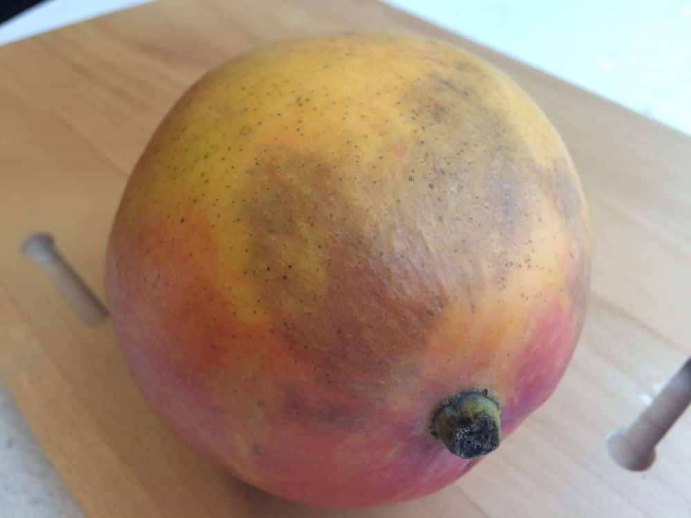 You can eat a mango with grayish skin (scald), but it may not taste as good.