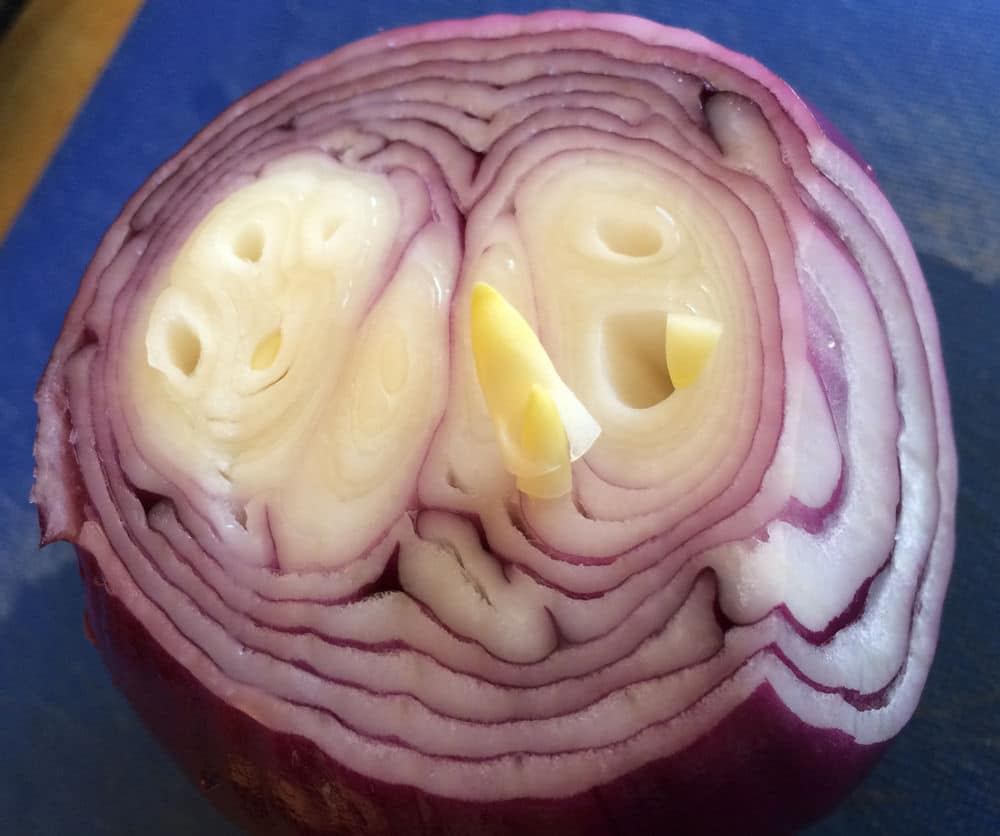 Little sprouts in a red onion