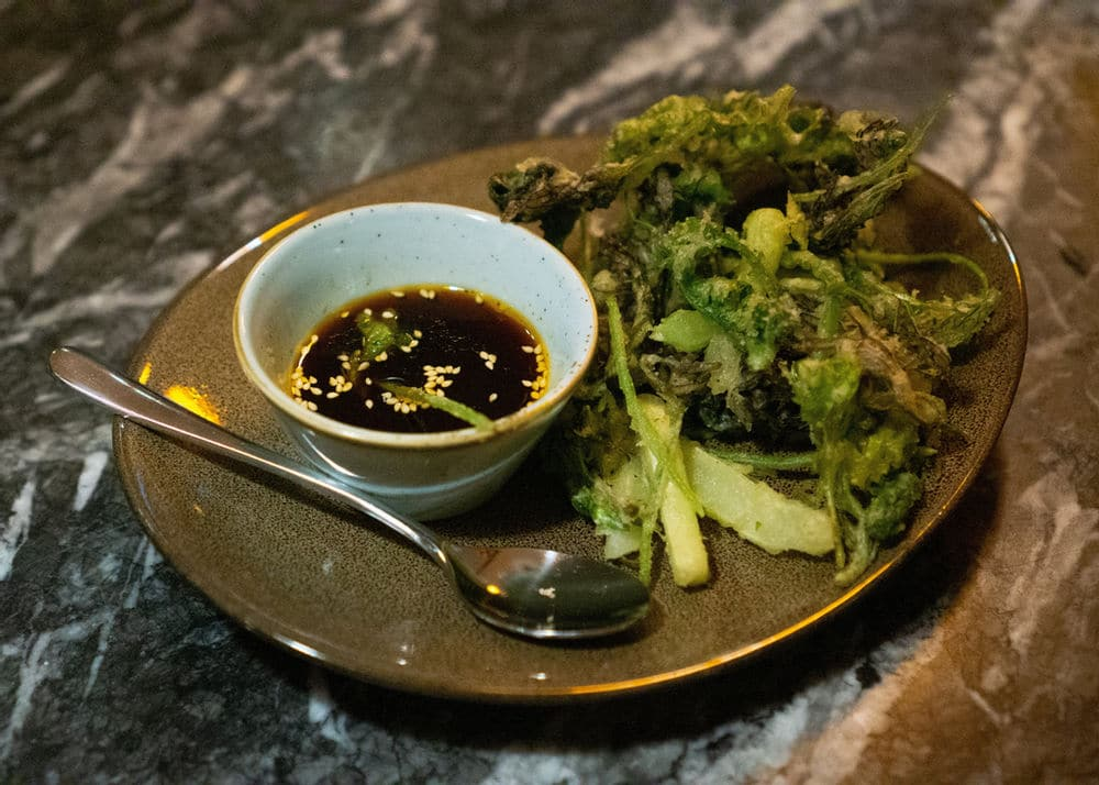 Tempura fried wilted greens, an upcycled dish