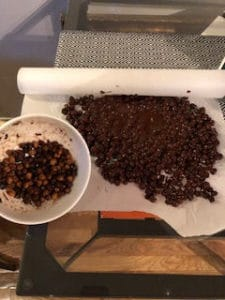 rolling roasted chickpeas in chocolate