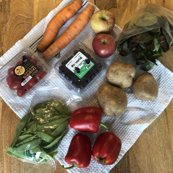 Fruits and vegetables inside a Hungry Harvest box