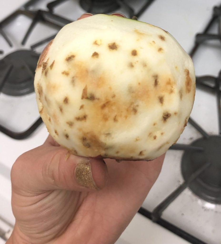 Peeled bitter pit apple
